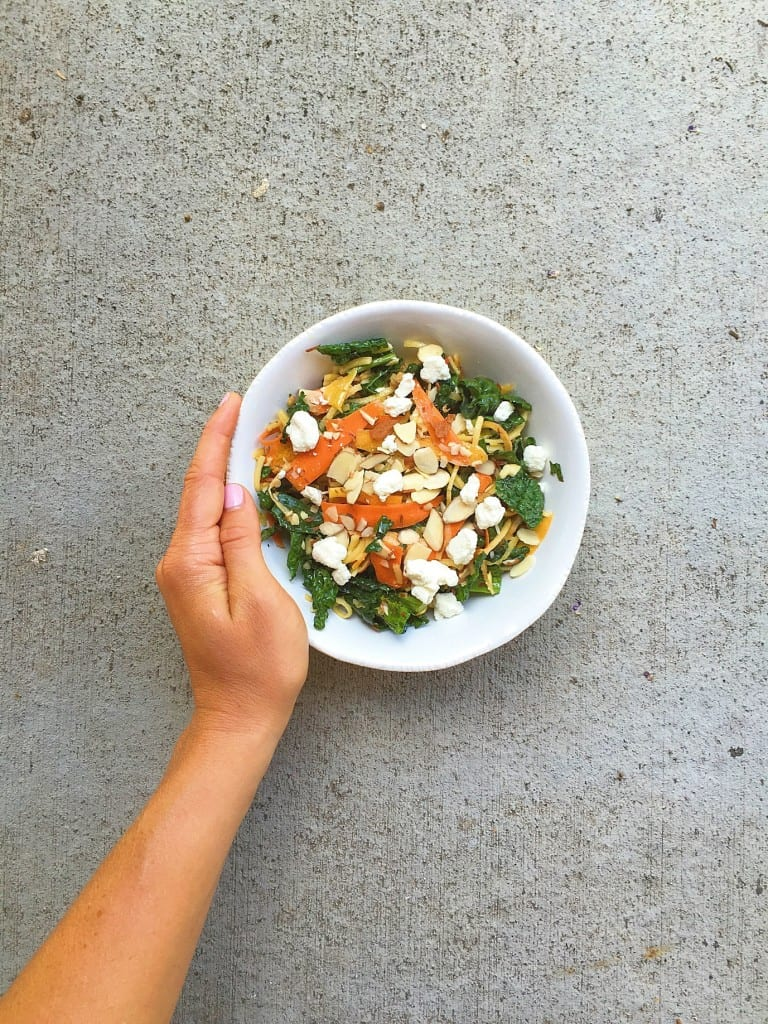 massaged kale and carrot salad with nuts and cheese_andhand