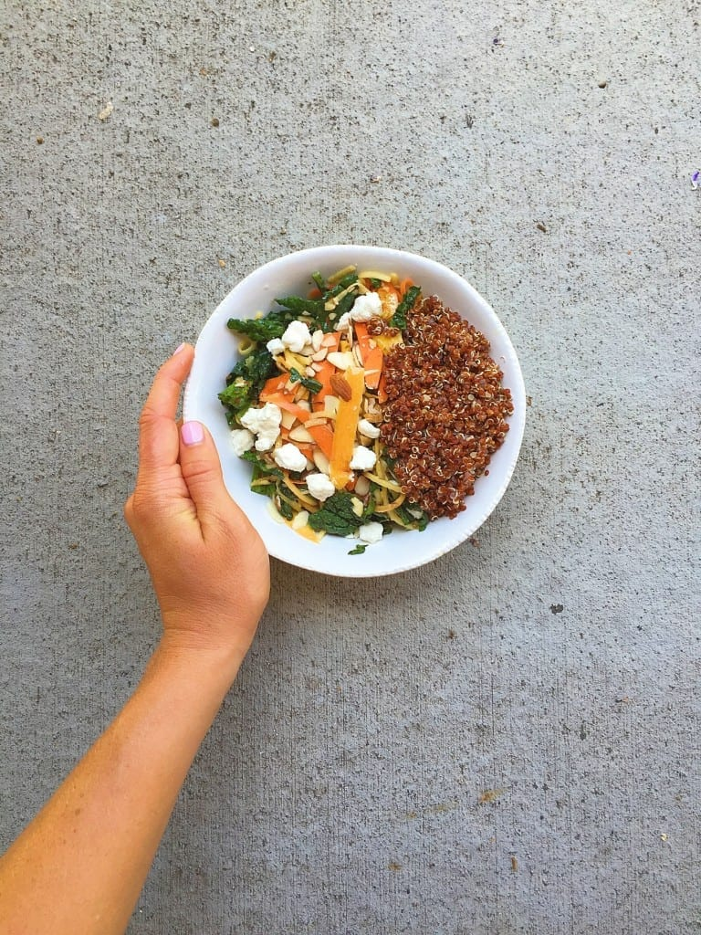 massaged kale and carrot salad with quinoa_and hand