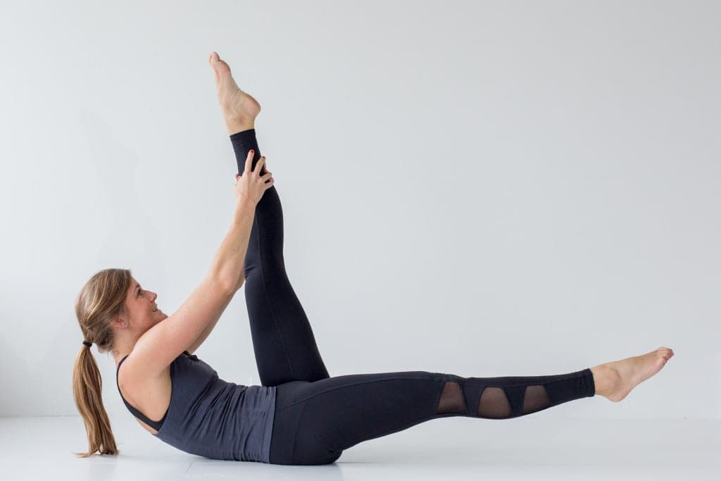 best barre exercises for flat abs - barre 100 ab series - straight leg pull and stretch -- www.nourishmovelove.com