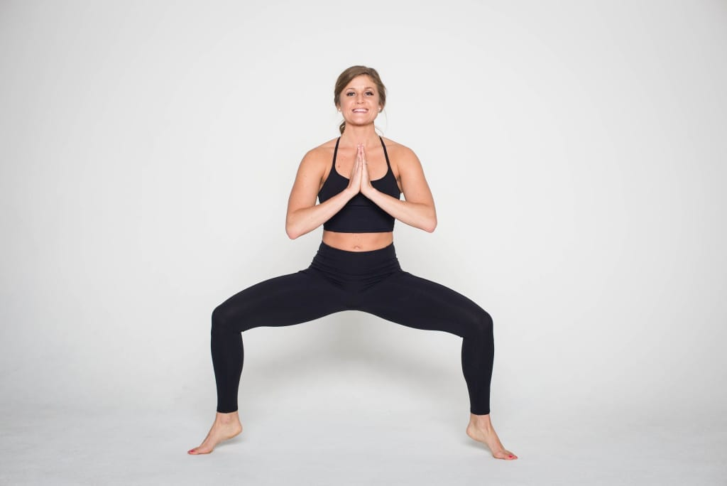 12 Squat Variations + Lower Body AMRAP Workout -- Plie Squat -- www.nourishmovelove.com