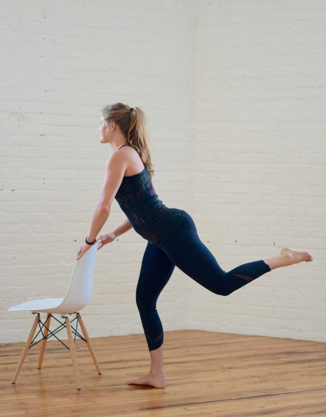 barre buns + thighs home workout | Grab a chair and get ready to tone your derriere with these 10 ballet-inspired moves! | www.nourishmovelove.com