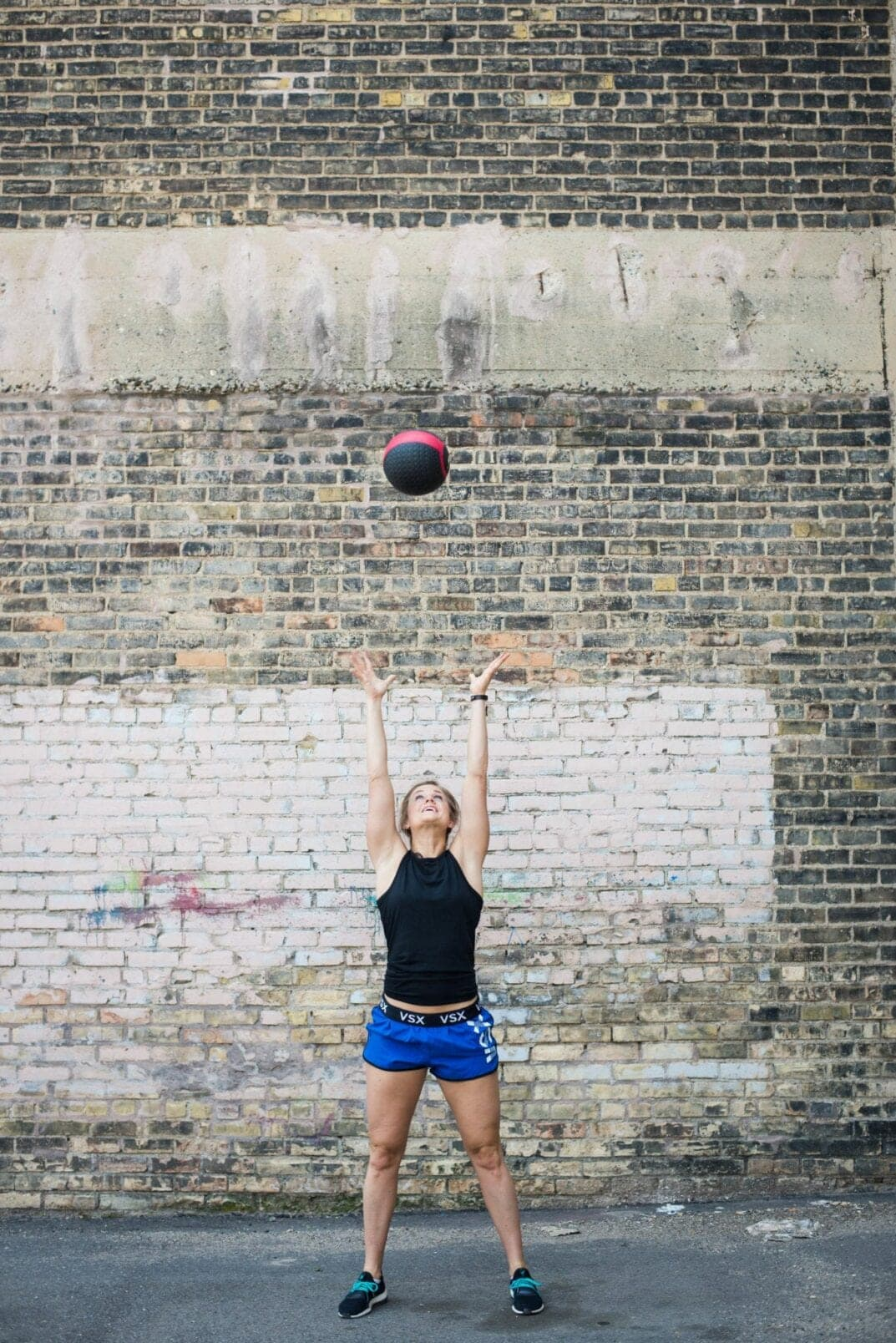 medicine ball squat and toss